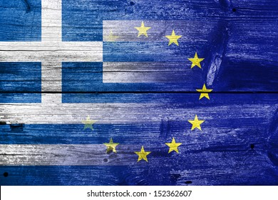 Greece and European Union flag painted on old wood plank background. The economic crisis in Greece