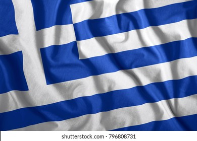 The Greece flag flies in the wind. Colorful national flag of the Greece. Patriotism, patriotic symbol.