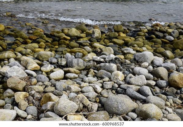 Greece, gravel on beach in Samothrace island