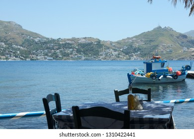 Greece the island of Telendos. A taverna at the waters with a view to the neighbouring island of Kalymnos