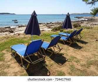 Greece, Island of Thassos, Psili Ammos beach.  Empty beach with umbrellas in the morning