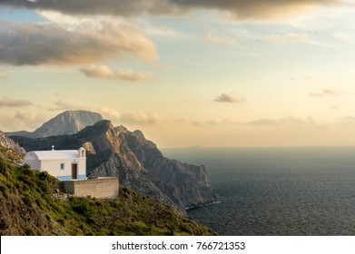 GREECE, KARPATHOS island, OLYMPOS :  a family chapel hangs in the middle of a cliff