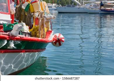 Greece, Kefalonia, Fiskardo, Relection of water on hull of boat in harbour