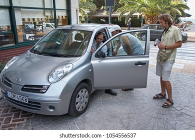 Greece, Loutraki - 27 Sep: Young people rent a car for autotraveling in Loutraki, Greece on September 27, 2007