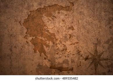greece map on a old vintage crack paper background