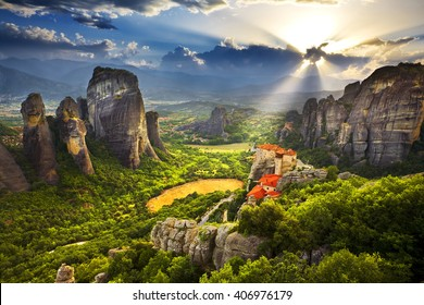 Greece. Meteora - incredible sandstone rock formations. The Holly Monastery of Rousanou and St. Nikolaos Anapafsas Monastery in background. The Meteora area is on UNESCO World Heritage List since 1988