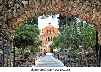 Greece, Rhodes, east coast, Kolymbia (Kolimbia), church Agios Nektarios with Epta Piges (seven sources). View from the gate arch to the church.
