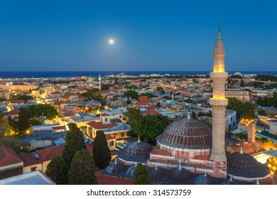 Greece, Rhodes - July 12  Panorama of the Old Town and the Mosque of Suleyman evening with the moon on July 12, 2014 in Rhodes, Greece