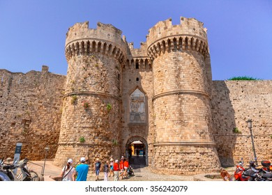 GREECE, RHODES - JUNE 11, 2015: Tourists visiting the Old Town at the Marine Gate (also Sea Gate) at the old city of Rhodes, Greece.