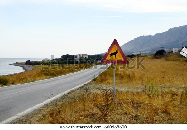 Greece, Samothrace island, warning sign for game pass with goats