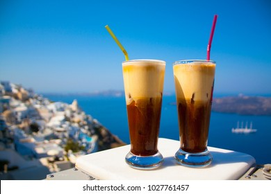 Greece Santorini island in Cyclades, coffee espresso freddo with wide sea of caldera in greek caffe
