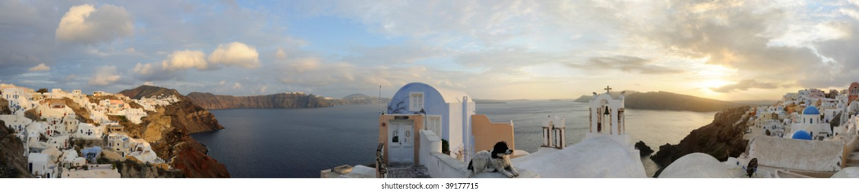 Greece. Santorini island. Oia village at the sunset in winter . Honey moon apartments. Panorama