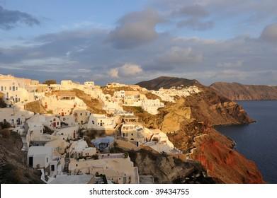 Greece. Santorini island. View on Oia village and caldera at the sunset