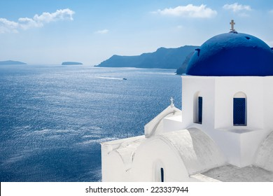 GREECE, SANTORINI- OCT 3: The greek church in the Oia village, sea view. October 3, 2014