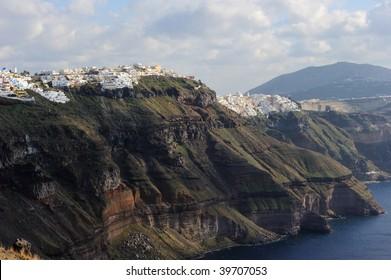 Greece. Santorni. View on precipitous mountainside of caldera, sea and town of Fira.