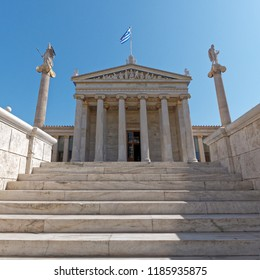 Greece, stairs to the academy of Athens main building with Athena and Apollo statues
