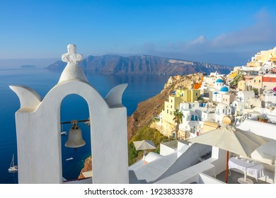 Greece. A sunny day on Santorini. Church bell and hotel terraces in Oia