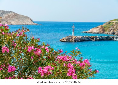 Greece Syros island wide view of the sea with syros main land in background at summer time, in cyclades