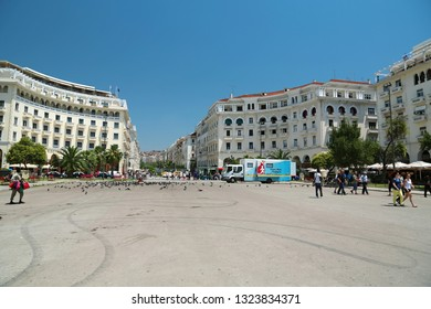 GREECE, THESSALONIKI, JUNE 10, 2013: People and pigeons on Aristotelous Square in Thessaloniki, Greece