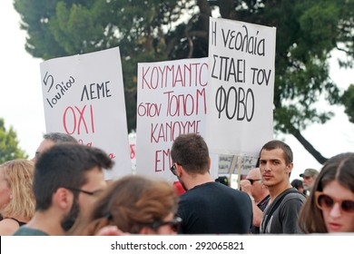 GREECE, Thessaloniki JUNE 29, 2015: Supporters of the NO vote in the upcoming referendum protest holding banners reading NO (OXI in greek) during a rally around the White Tower in Thessaloniki