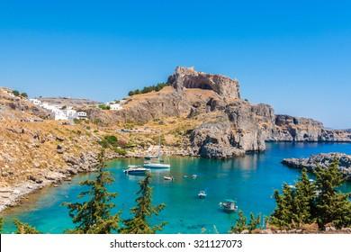 Greece trip in summer, Rhodos island, Lindos, Beautiful cove at St Pauls Bay, Acropolis of Lindos
