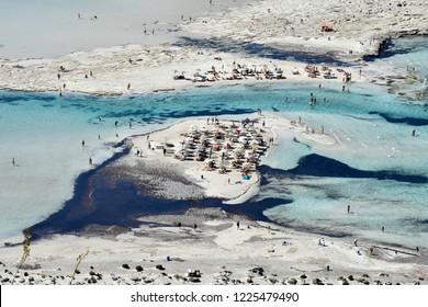 Greece, unidentified people enjoy the blue sea of Balos lagoon on Gramvoussa peninsula near Kissamos