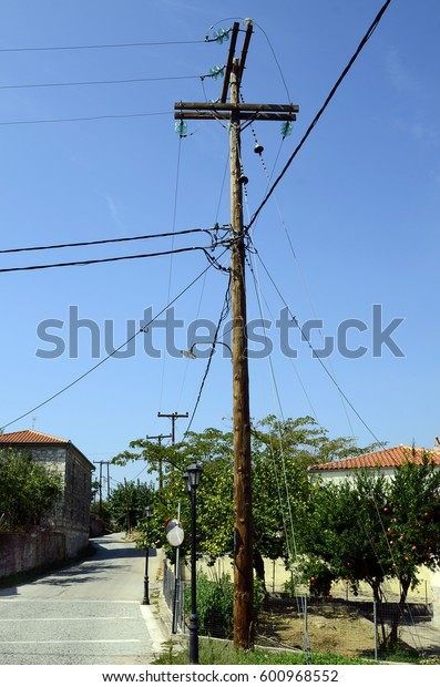Greece, utility pole and lamppost in rural village Dadia in Evros area