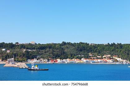 Greece. View from the sea to the embankment of the coastal village of Katakolon
