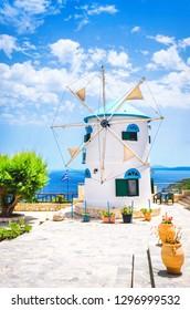 Greece white windmill at summer day, Zakynthos island. Vertical orientation.