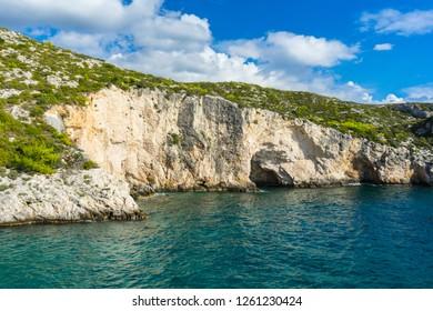 Greece, Zakynthos, Abrupt white chalk rock cliffs of Porto Limnionas bay