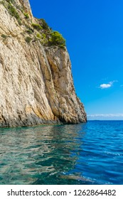 Greece, Zakynthos, Abrupt white chalk rock cliff wall and turquoise waters