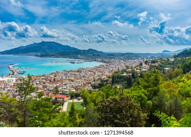 Greece, Zakynthos, Endless view over stunning mountain landscape, harbor and houses of zante town