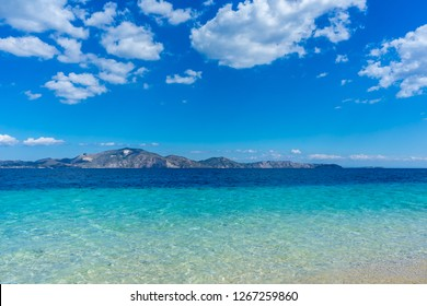 Greece, Zakynthos, Ideal azure blue clean water at sand beach with view on Zante island from Marathonissi