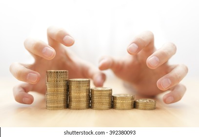 Greed for money. Hands grabbing coins.