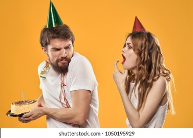 greedy birthday with cake, guests, woman