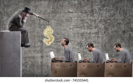 A greedy businessman motivates office workers with a salary. Office slavery concept.
