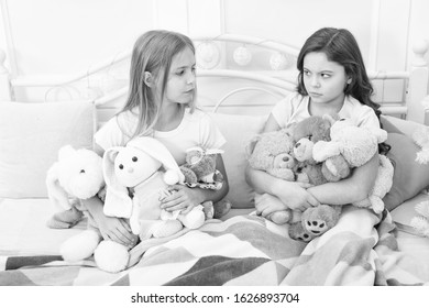 Greedy kids concept. Sisters relations issues. Share toys with friends. Children in bedroom play toys. She dont want to share her toys. Sisters rivalry problem. Offended feelings. Frowned expression.