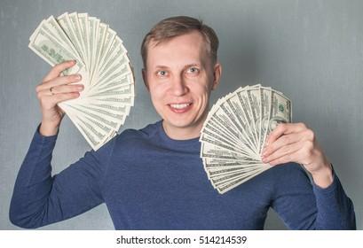 greedy man Displaying a Spread of dollars Cash