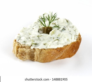 greek appetizer(tzatziki) on a slice of bread