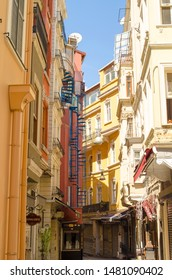 Greek architecture. Narrow streets. Facades of houses in the Mediterranean style. A popular tourist destination, the historical center of Istanbul. Turkey, Istanbul, Beyoglu, Taksim - August 2019.