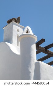 Greek Architecture Stark white greek home against clear blue cycladic sky of Mykonos Greece