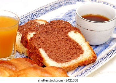 Greek breakfast cake with coffee and peach juice