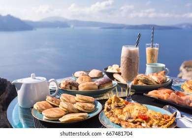 Greek breakfast with omlet and yogurt  at Mediterranean sea. Oia, Santorini island, Greece