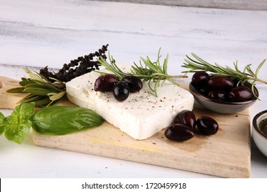 Greek cheese feta with rosemary and olives. Healthy ingredient for cooking salad. Chopped Goat feta cheese