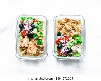 Greek chicken grain lunch box. Lemon herbs chicken, couscous, vegetables, olives, feta cheese lunch box on light background, top view. Mediterranean food concept