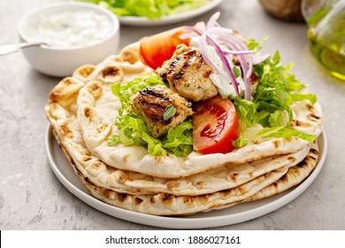 Greek chicken souvlaki ona pita with fresh vegetables with tzatziki sauce