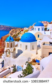 Greek church with blue domes in Oia in Santorini island, Greece