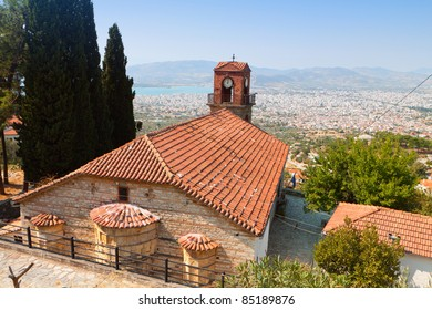 Greek church located at 'Ano Volos' village at Pelion in Greece.  The view downside is the city of Volos