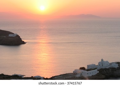 Greek coast with old church at sunrise