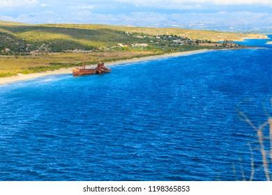 Greek coastline with the famous rusty shipwreck Dimitrios in Glyfada beach near Gytheio, Gythio Laconia Peloponnese Greece. View from distance.
